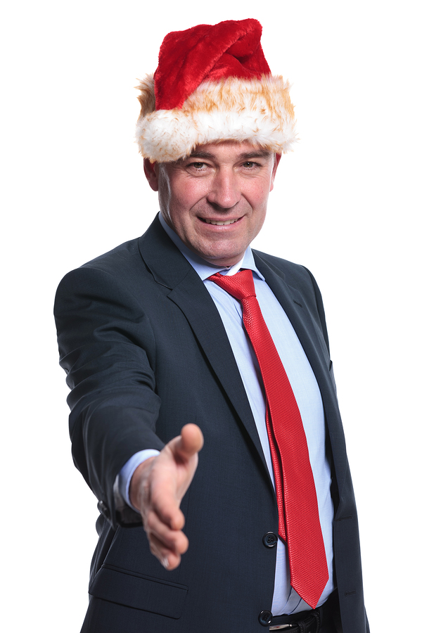bigstock-old-business-man-in-christmas--54525593.jpg
