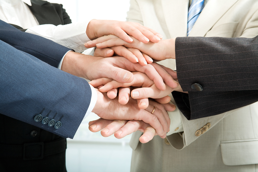 bigstock-Business-people-joining-their--16971125.jpg