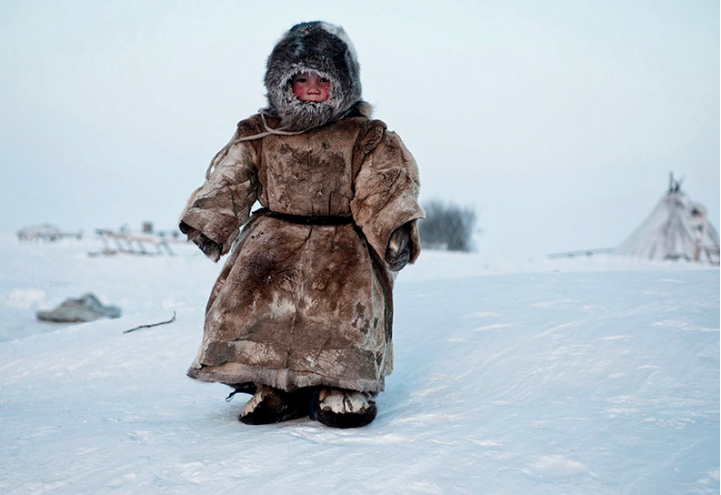 Siberia: a young Nenets boy plays in -40 degrees on Yamal in the winter.