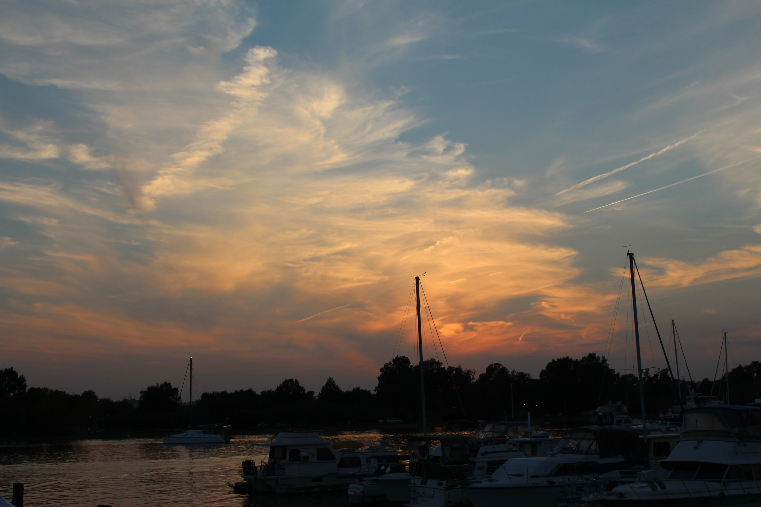 View of the early evening sky from one of the boats bobbing on Gangplank Marina. Photo credit: Amel Guettatfi