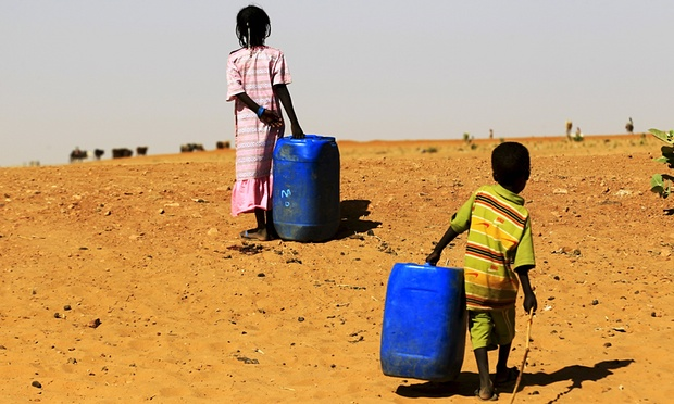 Two children fleeing from the violence in Sudan's East Jebel Marra reach the Zam Zam camp for displaced people. Credit: Mohamed Nureldin Abdallah/Reuters (Source: The Guardian)