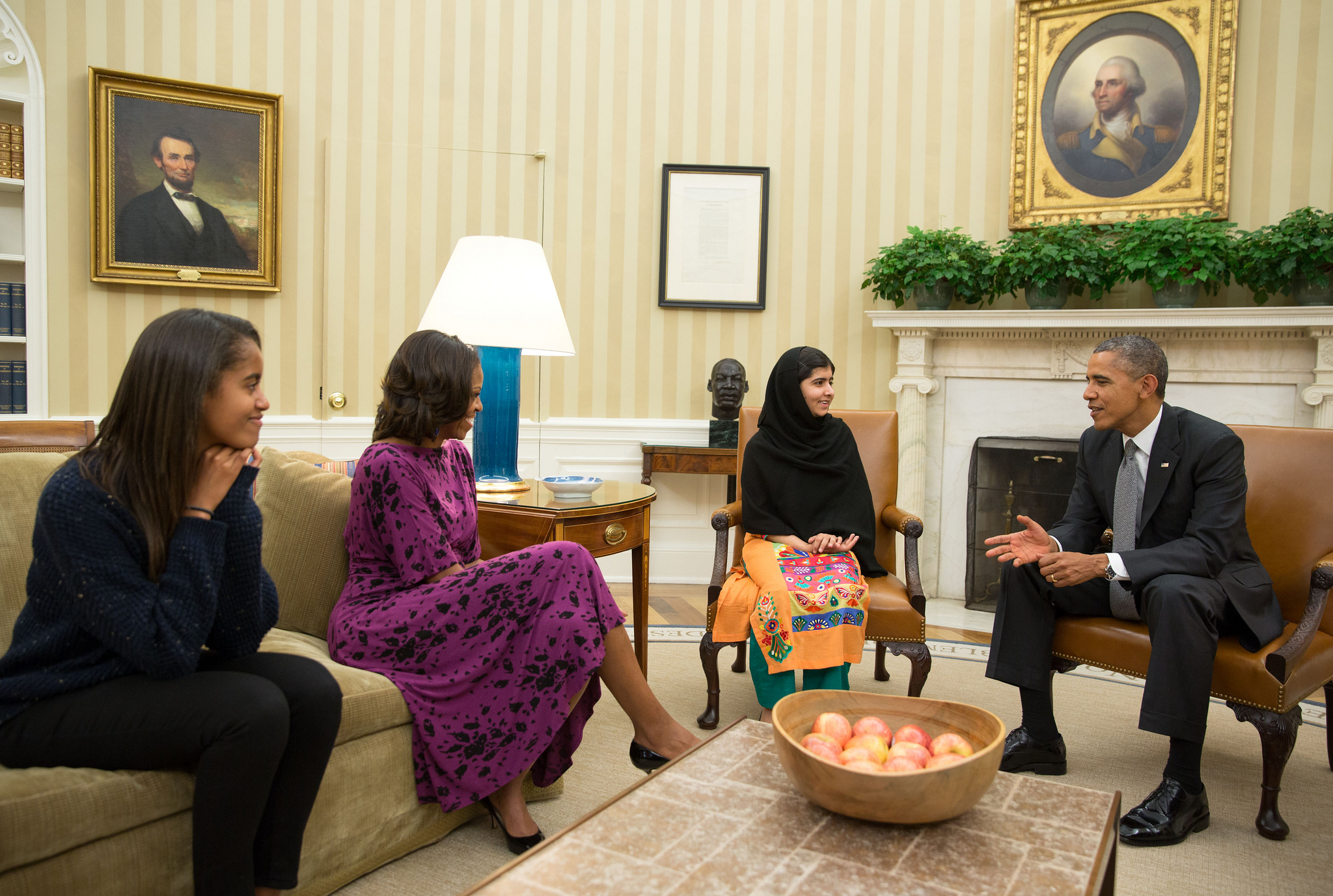 U.S. President Barack Obama, First Lady Michelle Obama and their daughter Malia meet with Malala. Credit:  White House