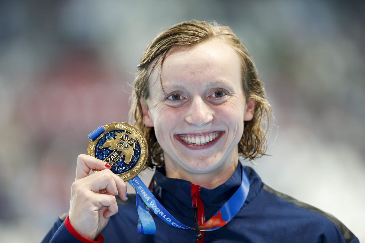 Katie Ledecky shows off her gold medal Saturday. Credit: Patrick B. Kraemer/EPA Source:  Los Angeles Times