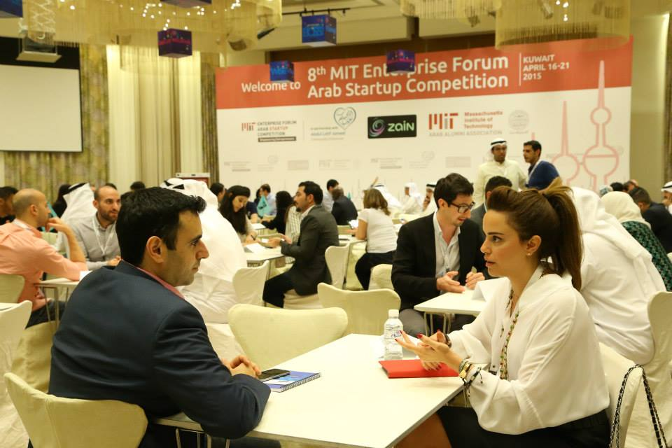Two competition participants talking during the eighth MIT EF Arab Startup Competition, which was held in Kuwait in April 2015. Cover source:  MIT EF Pan Arab (Competition's official website)