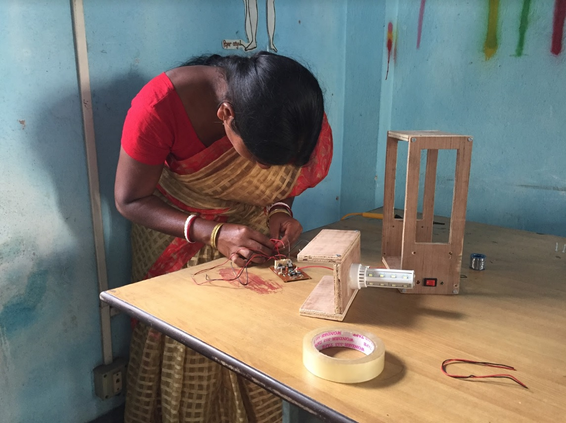 Indian woman works on a sustainable solar lamp. Credit: Ambra Dentella