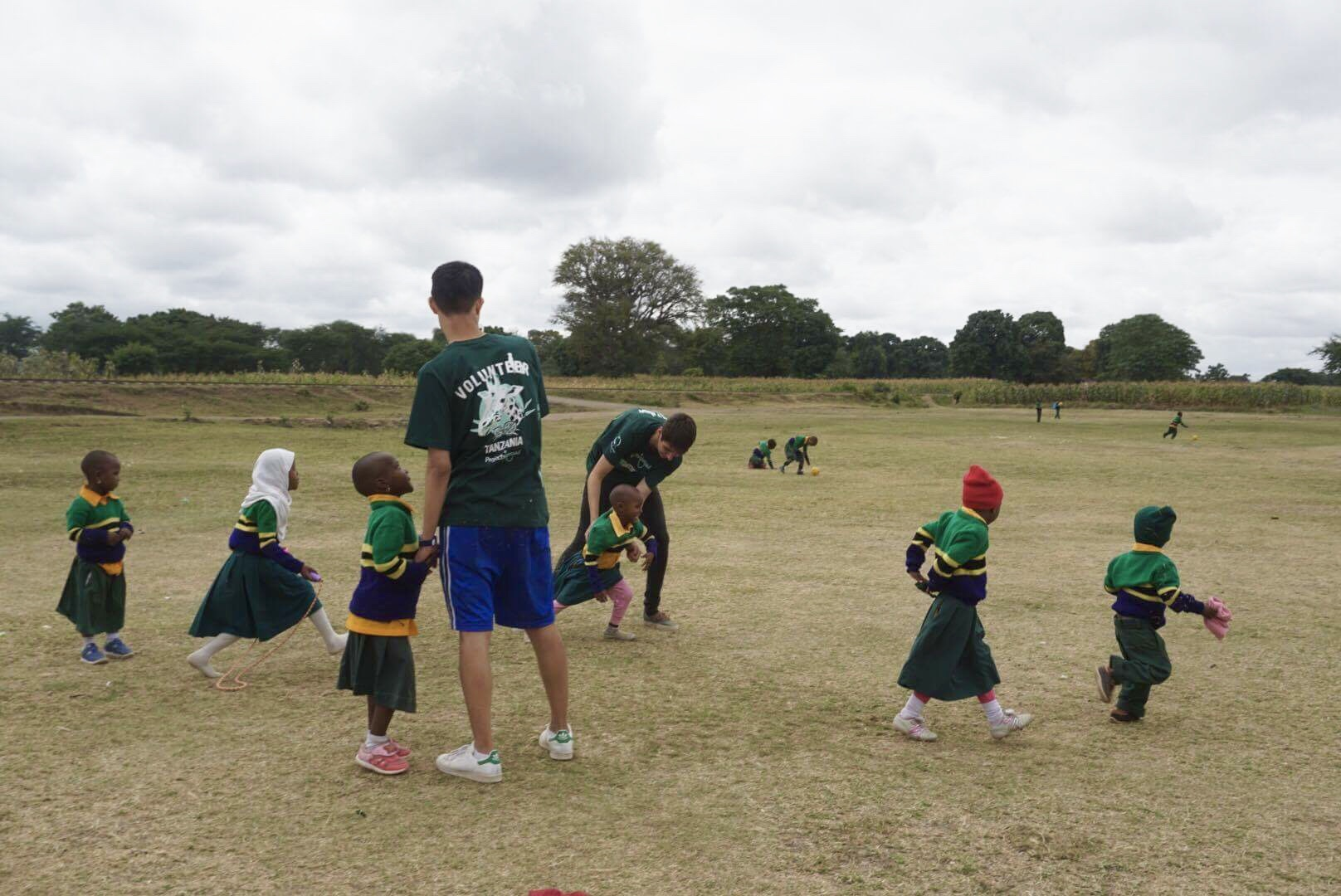 Volunteers playing with students in Arusha, Tanzania