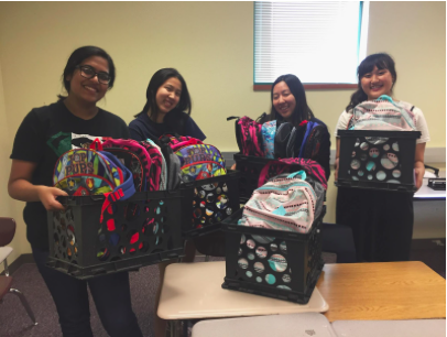 Filled backpacks we donated to a local Title One elementary school.