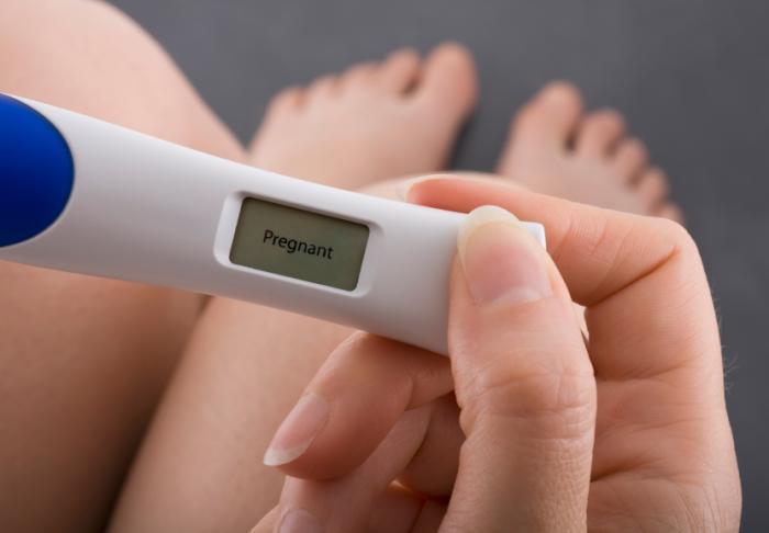 woman-holding-pregnancy-test.jpg