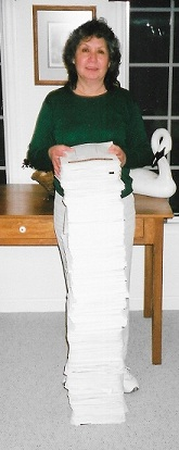 Kathy with a few of her 84,777 signed petitions