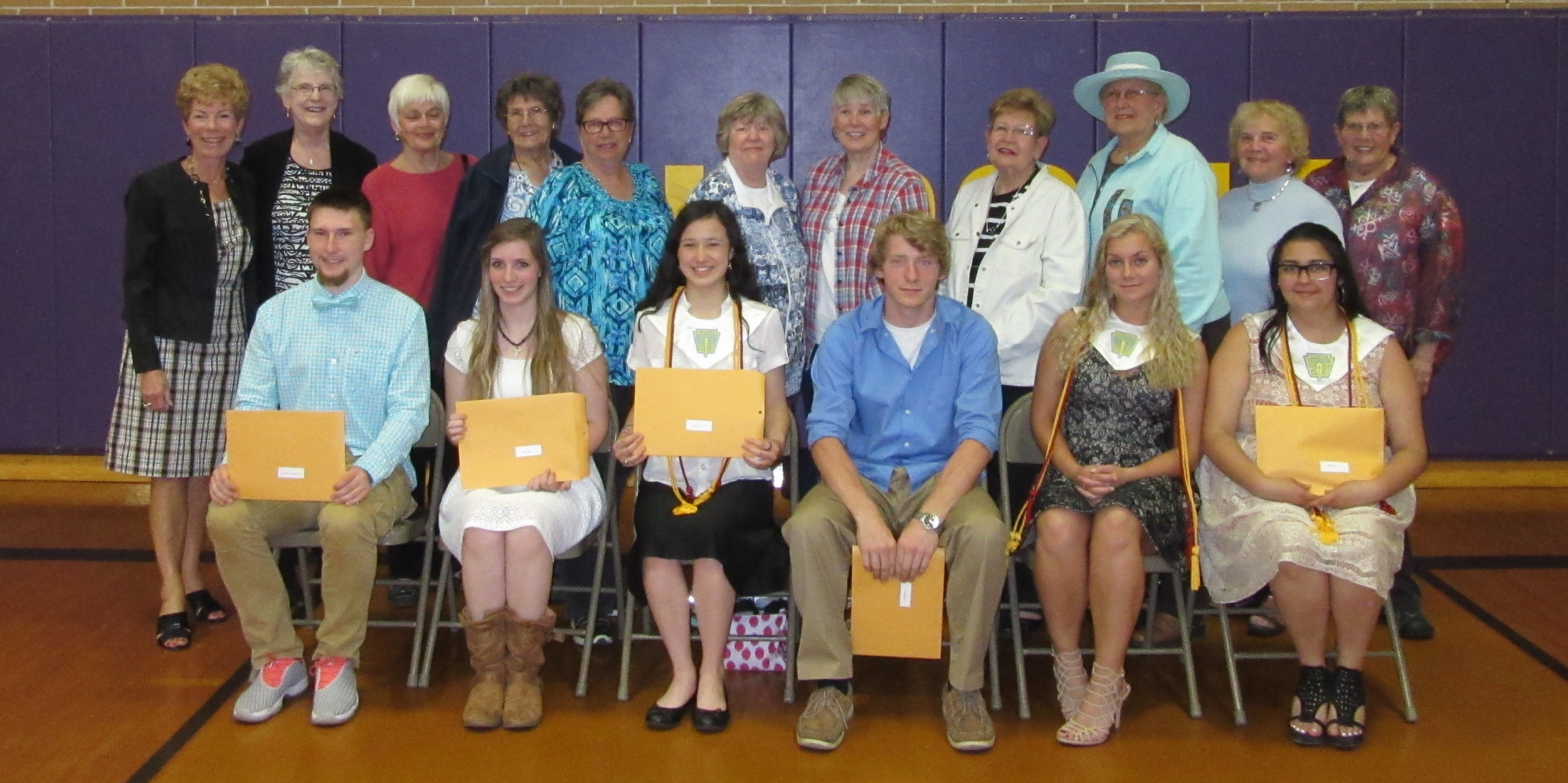 The Pentwater Women's Club awarded $9000 in scholarships to six  graduating seniors on Monday, May 23rd during the school's Honors  Assembly.  Students receiving scholarships, seated left to right, are Jacob Emick-Free, Sarah Jewett, Sophia Nyborg, Connor Patterson, Emily Gebhart and Chyanne Smith.                                                                              They were joined by Pentwater Women's Club members, back row left to right, Norma Oly, Nancy Mertes, Treasurer Janet Nelson, Elaine Bell, Deborah Atchetee, President Sally Ouweneel, Deborah Leishman, Juanita Pierman, Ways & Means Chairperson Vicki Poplstein, Judy Jankowski, and Scholarship Chairperson Kathy Davis.