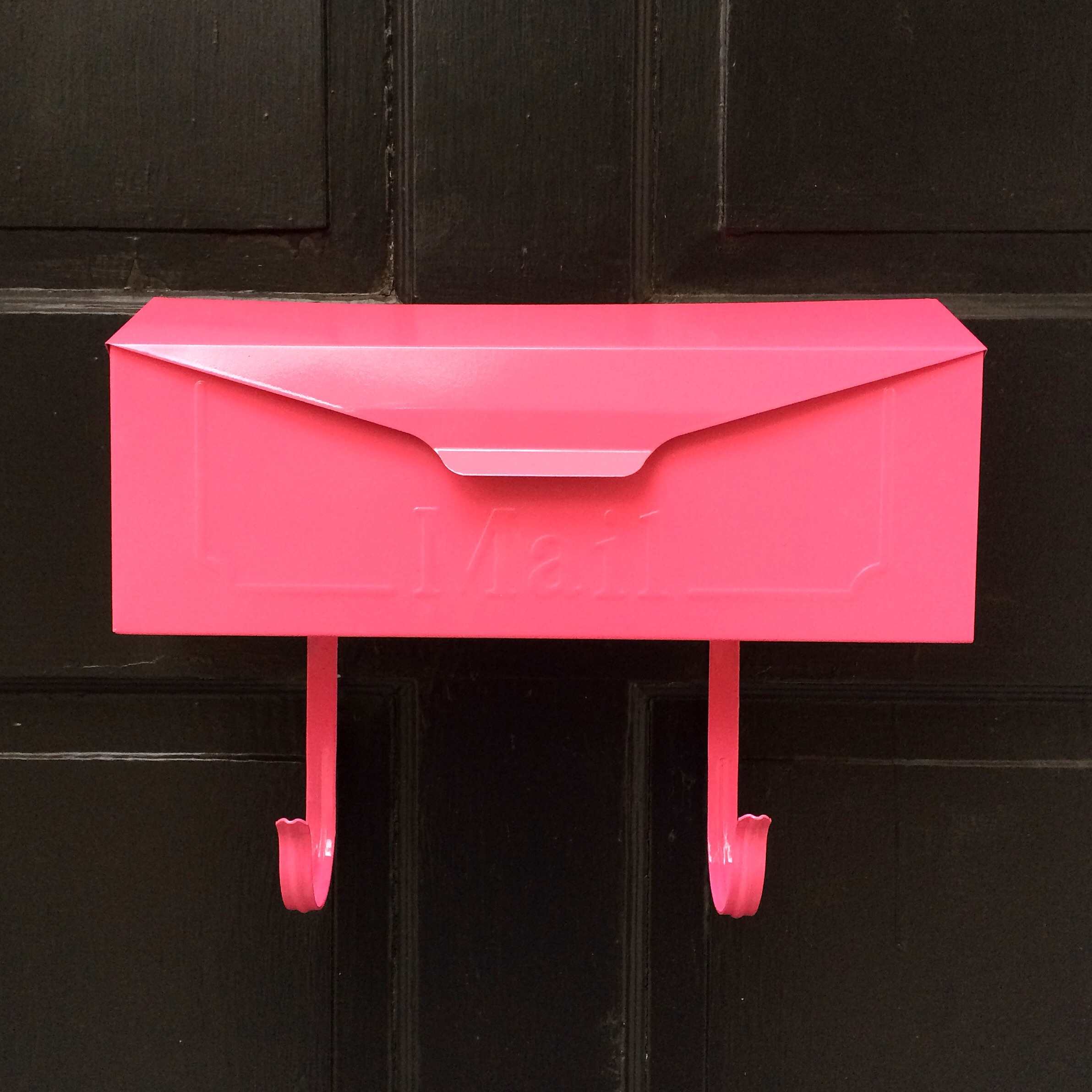 This mailbox had a big year too! It went from black to pink to black again!