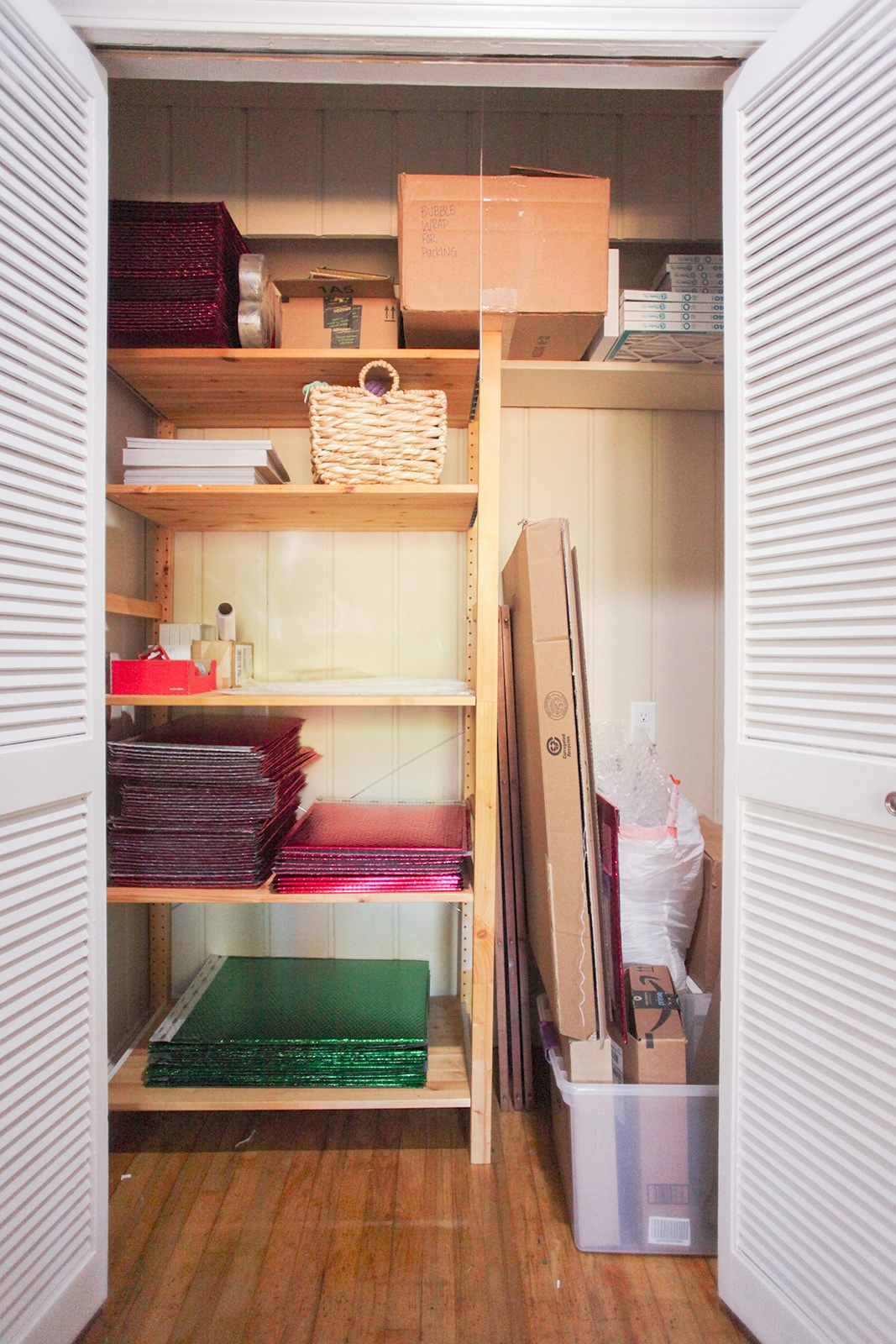 Can you believe it? The shelf is in the closet. So much better.