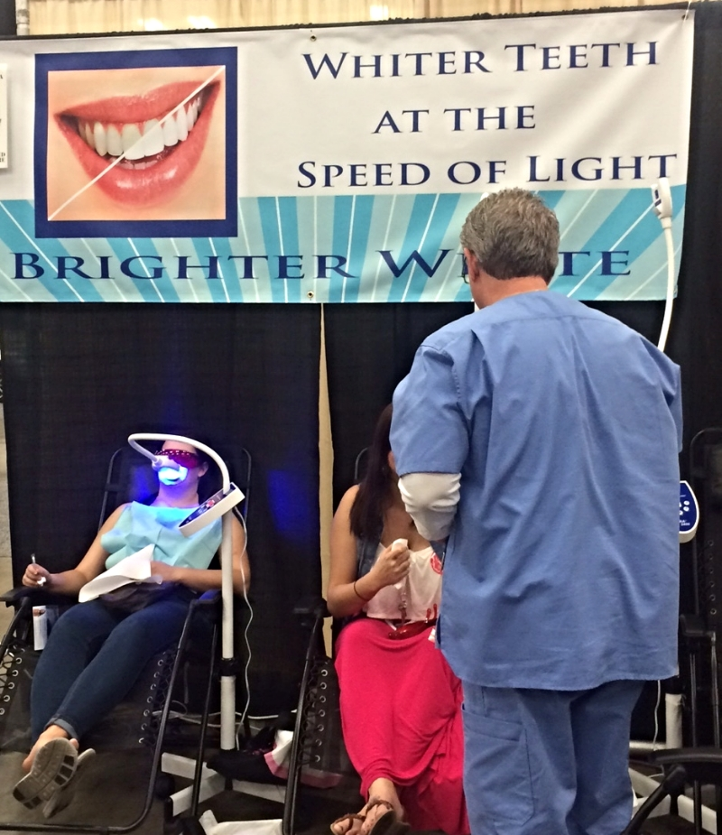 After you get your nerves analyzed, you can also get your teeth whitened at a bridal show. That's what's nonchalantly happening here.