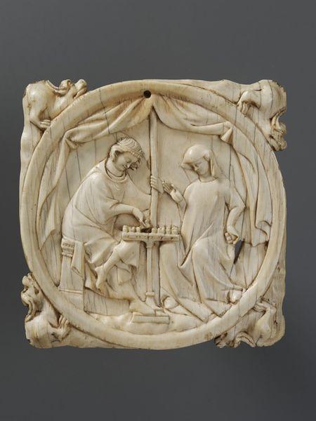 Szerelmes sakkozok 14. századi elefántcsont faragvány (vam.ac.uk).