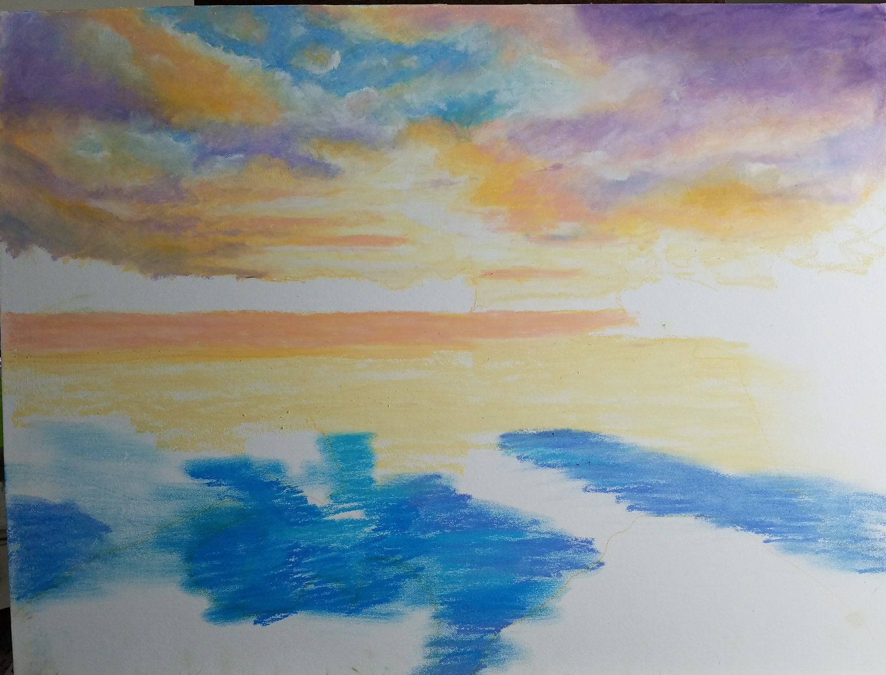 Blocking in the sky. Part of the fun is smushing the pastel around and blending areas.  I use my fingers (I wear gloves) and silicone color shapers for blending. I use Myngyo Gallery pastels for most of the painting, with some of the much softer white Sennelier oil pastel for adding light and blending colors.