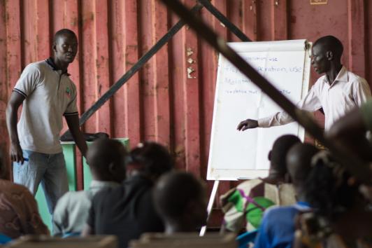 Matthew training community health agents in Yei on the operation and construction of biosand filter technology, February 2016.