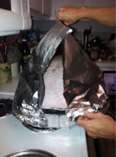 "Construct ""foil tent"", tucking foil under the edge of pan"