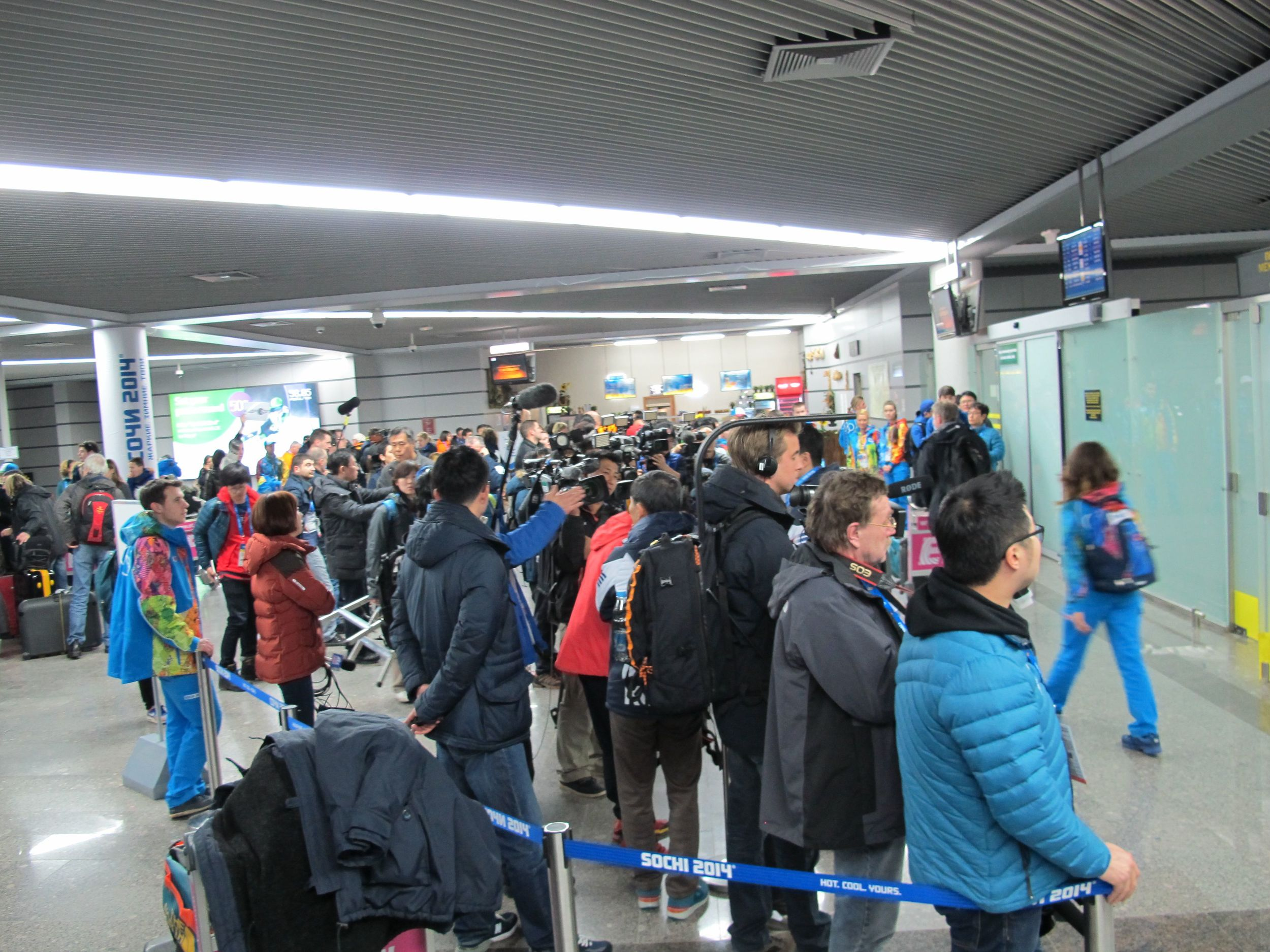 At the Sochi airport, TV crews greeted arriving athletes.