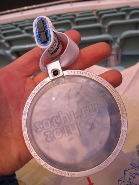 Everyone in the stadium had to wear one of these lights, which flashed different colors at different moments. Each bears the words Participant 2014 Olympics.