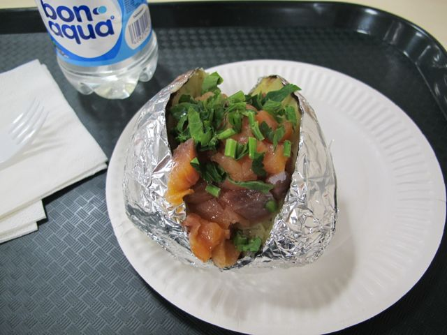 Lest anyone think I was making fun of the baked-potato vending stands in Olympic Park in my last post, this was my lunch yesterday in the cafeteria. The potato topping of the day was chopped-up smoked salmon. Not bad at all.