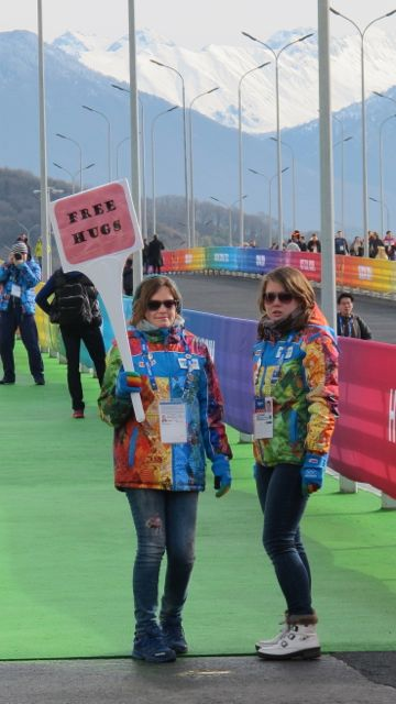 How can anyone not like Olympics at which volunteers are giving out free hugs?