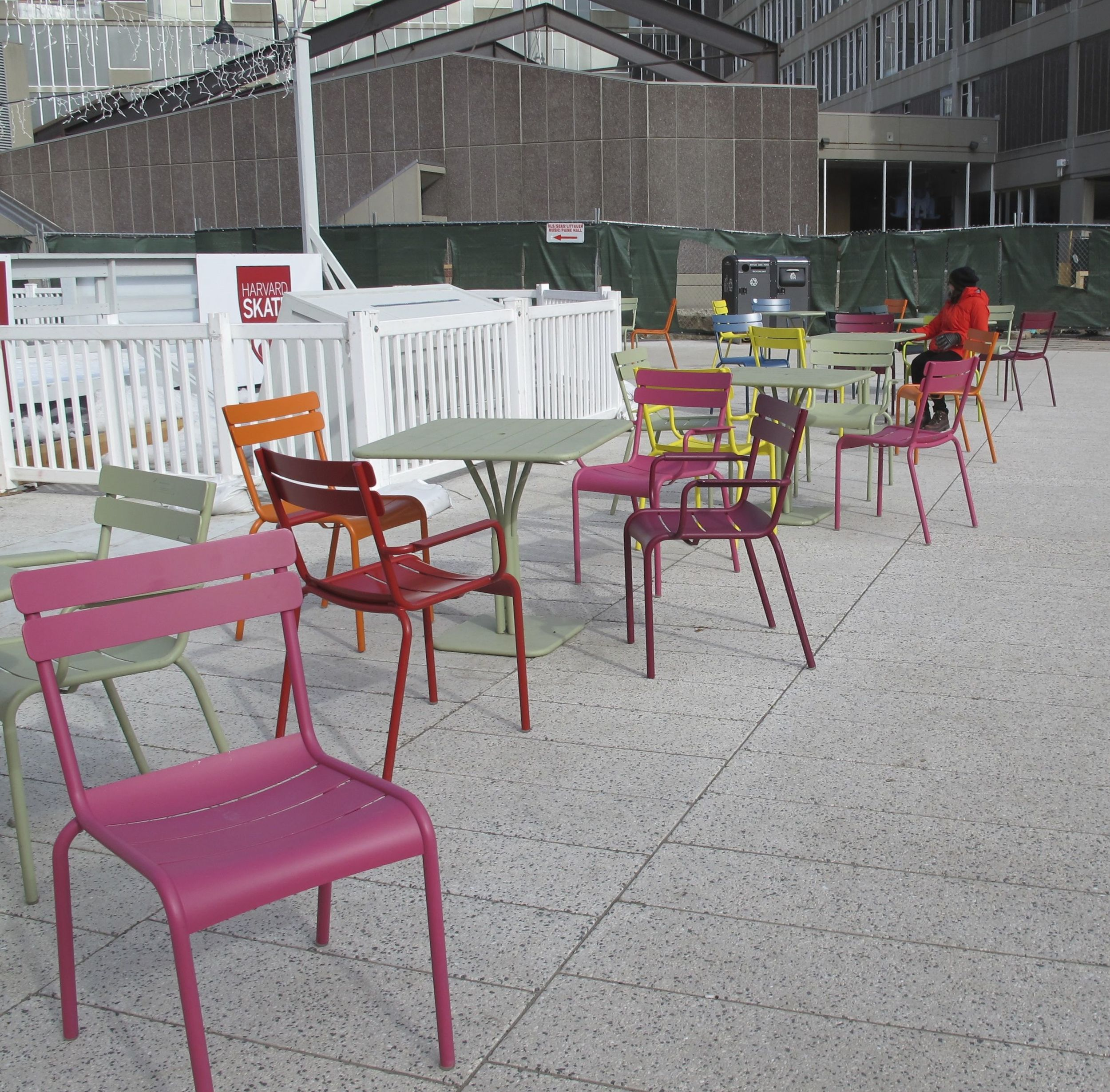 We wandered the Harvard campus quite a bit during our visit. Near the school's outdoor skating rink we saw some tables and chairs... and Pamelia saw a 13.7-billion-year spectrum waiting to happen. So we began moving everything around....