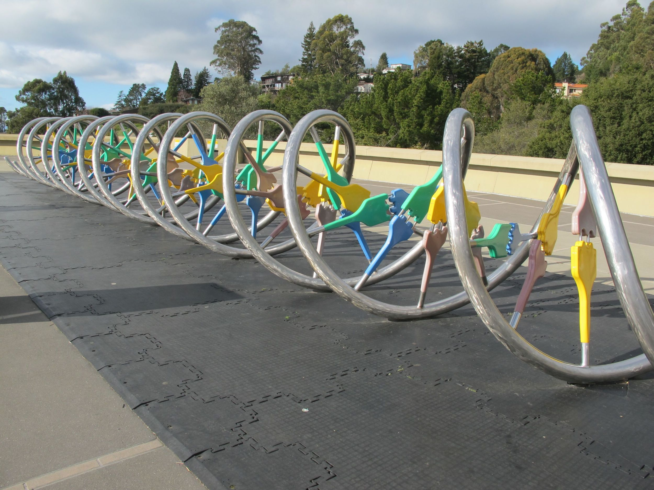 Outside the Lawrence Hall of Science is a large model of DNA. Those silvery pipes are the tk. The plastic connectors .