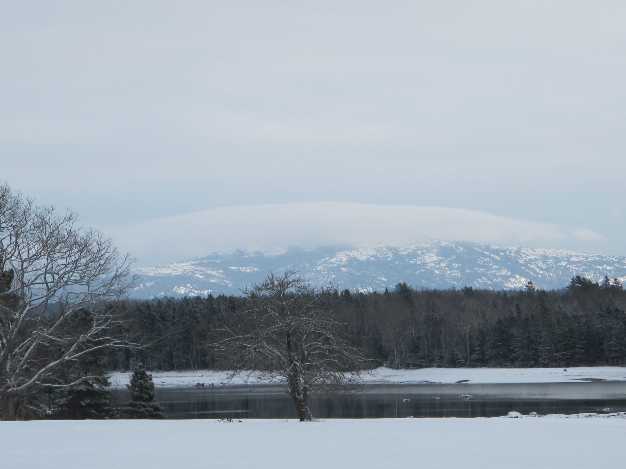 No, the snow isn't 100 feet deep atop Cadillac Mountain, though it looked that way when we took a walk the other day. That white cap was just a cloud that crawled over the peak and moved on.
