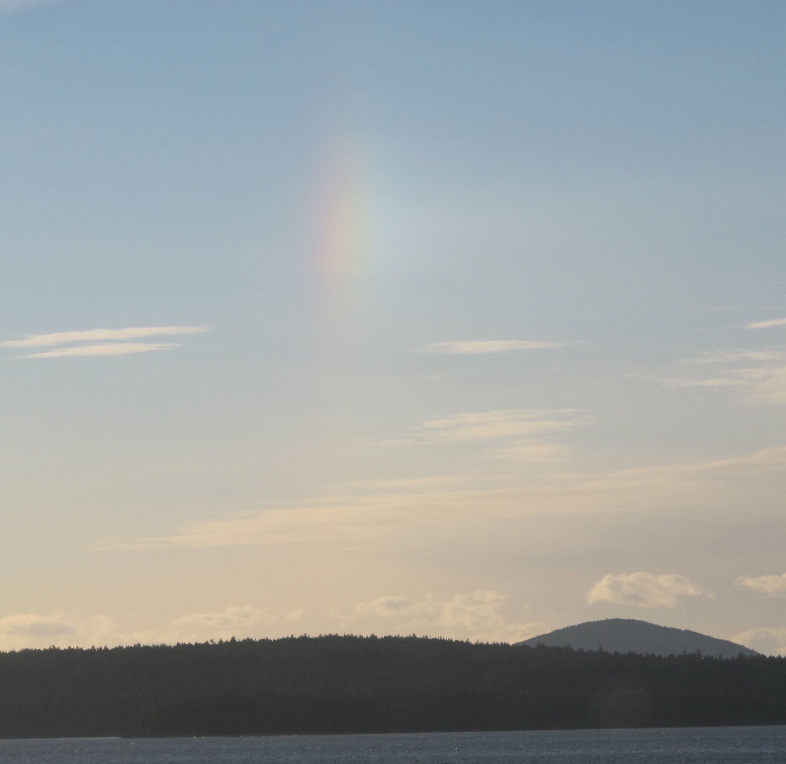 We saw this vertical ice-crystal rainbow one morning this week. It's called a Sun dog, and it's created by sunlight hitting fine ice crystals nicknamed diamond dust, which act like prisms. It can happen in very cold weather.