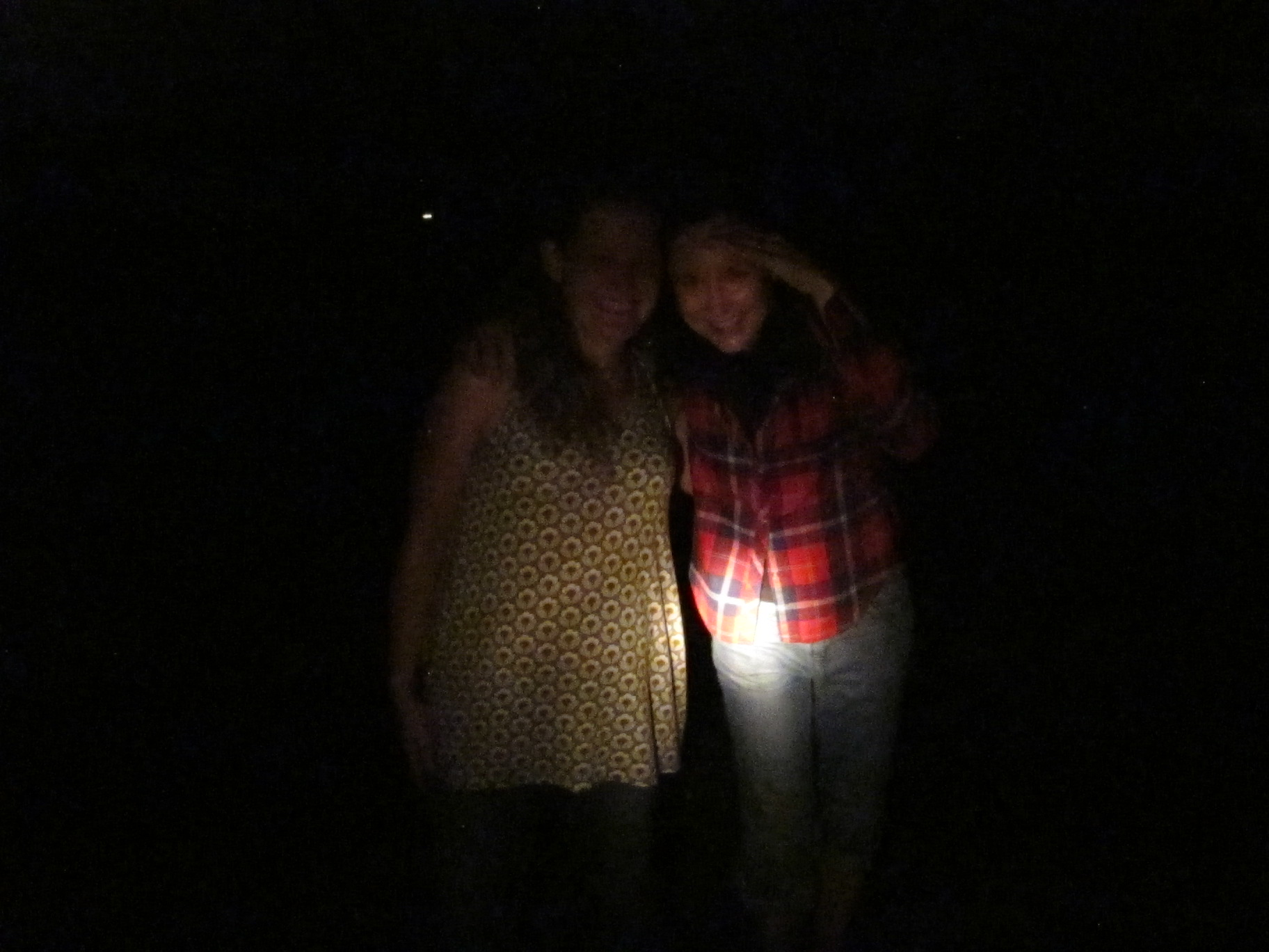 Two of our night explorers, Lisa and Pamelia, illuminated by flashlight, not phytoplankton.