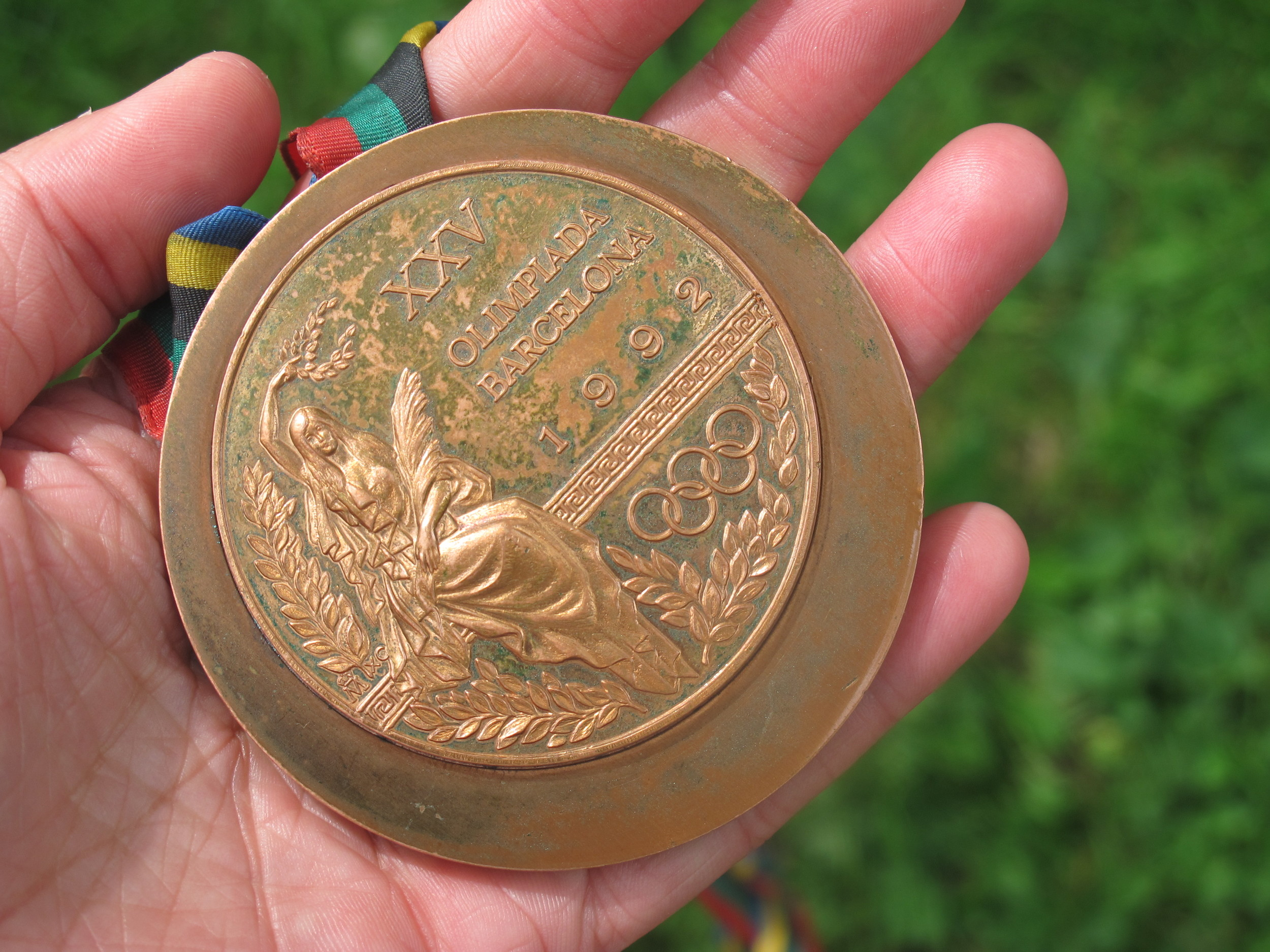 Lynn brought along her 1992 Olympic bronze medal, which she won in the 10,000 meters. I gave the young YMCA runners paper and pencils so they could do rubbings of it.