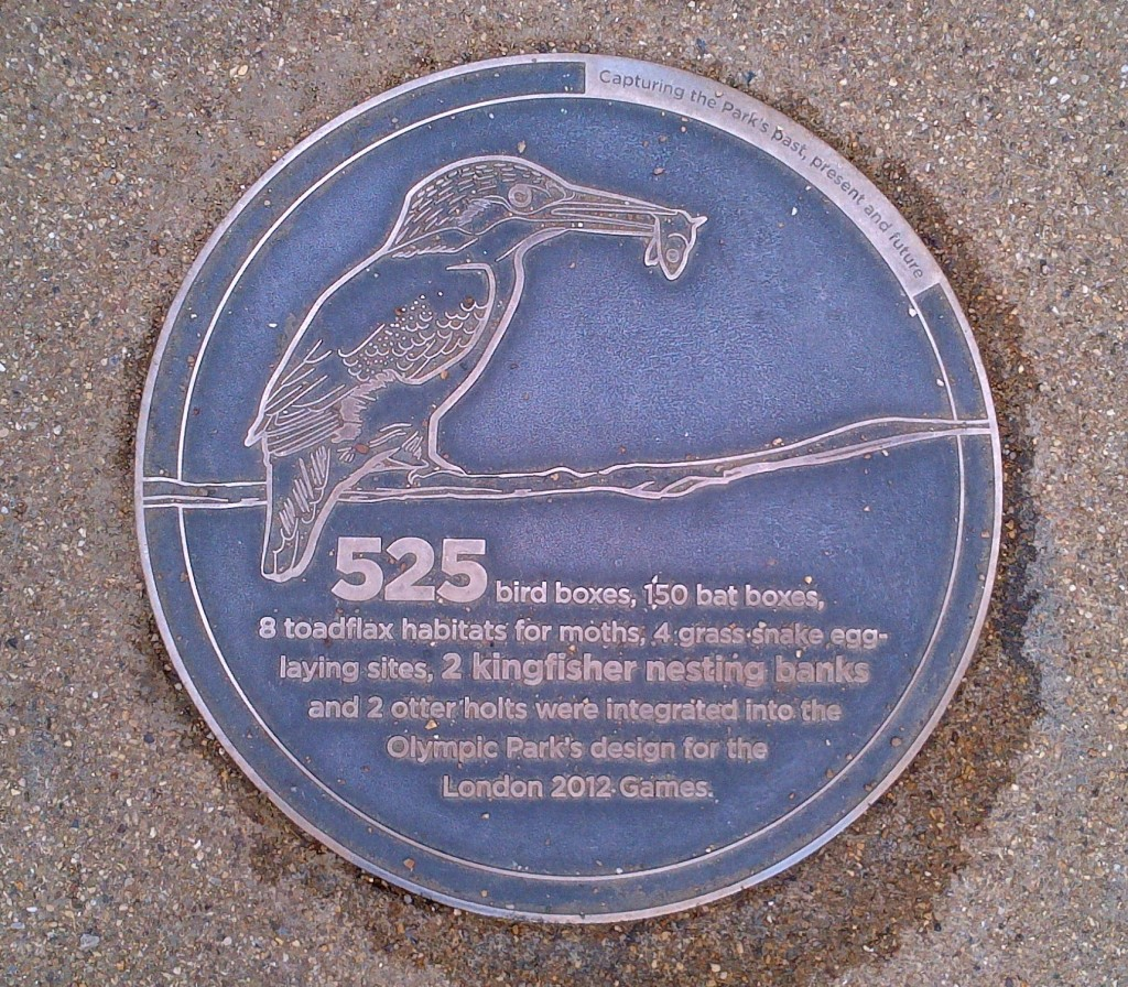 Large medallion embedded in a walkway at the Olympic Park.