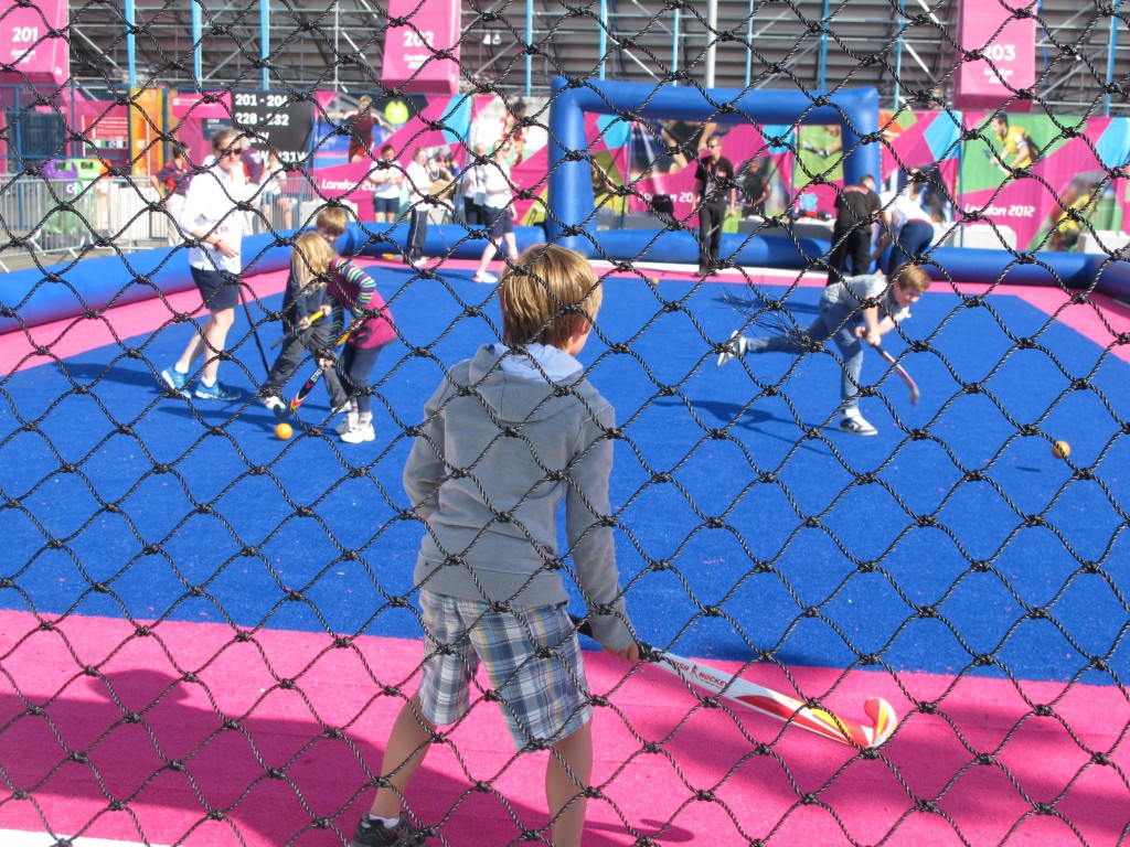 Outside the Olympic field hockey stadium is a mini-field on which kids can learn basics of the game—or just have fun.