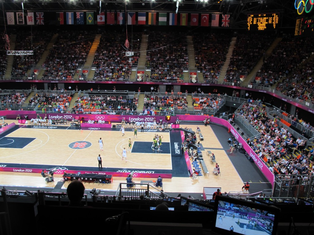I caught the last two quarters of a Lithuania-France basketball game. This temporary arena will be moved to Glasgow, Scotland, to be used in the 2014 Commonwealth Games and may then be relocated to Rio for the 2016 Olympics.