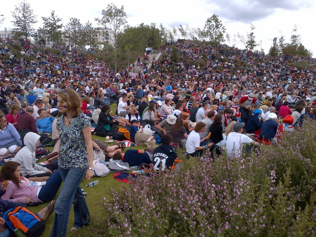 The Olympic Park is packed these days, with six-figure crowds common. These folks are all watching a giant video screen.
