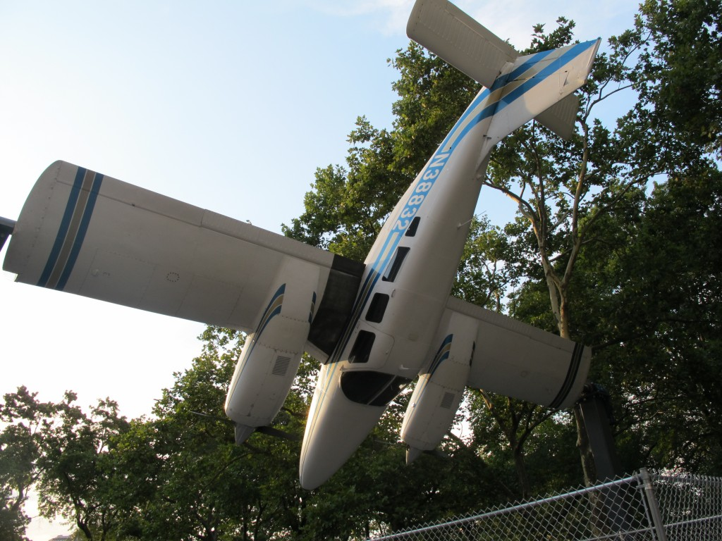 This unusual piece of public art sits just outside Central Park, near the corner of Fifth Avenue and 60th St. It's by Paola Pivi, an Italian-born multimedia artist who now lives in Anchorage, Alaska, and it is a six-seat Piper Seneca airplane that has been modified so that it can rotate, end over end, while attached to upright braces by its wingtips. It was inspired by a story about three modern art pioneers, Constantin Brancusi, Marcel Duchamp and Fernand Leger, who were amazed by what they saw at the 1912 Paris Air Show. The motor-driven piece flips over and over is aptly called How I Roll.