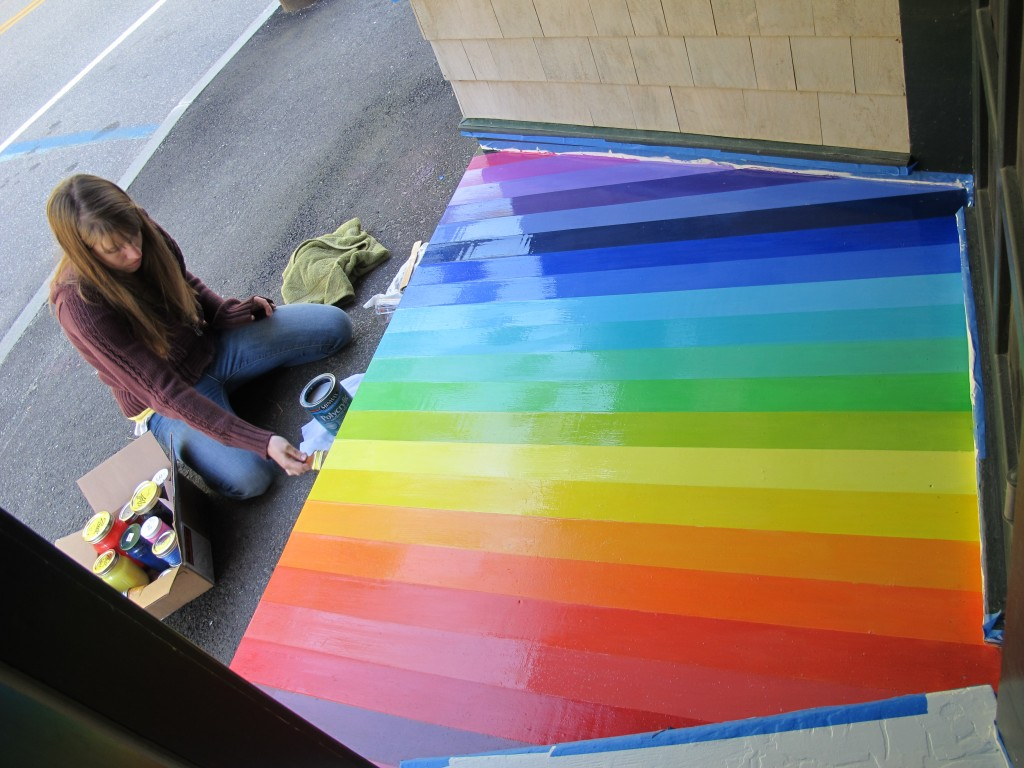 The spectral stoop at the Notebook is ready. Here Julie is adding a coat of polyurethane to complete Eli's brilliant idea. It has been fascinating to watch the reaction of passers-by to this work of art—drivers have even turned their cars around just to make sure they saw what they think they saw. Just wait until they see what's inside the Notebook.