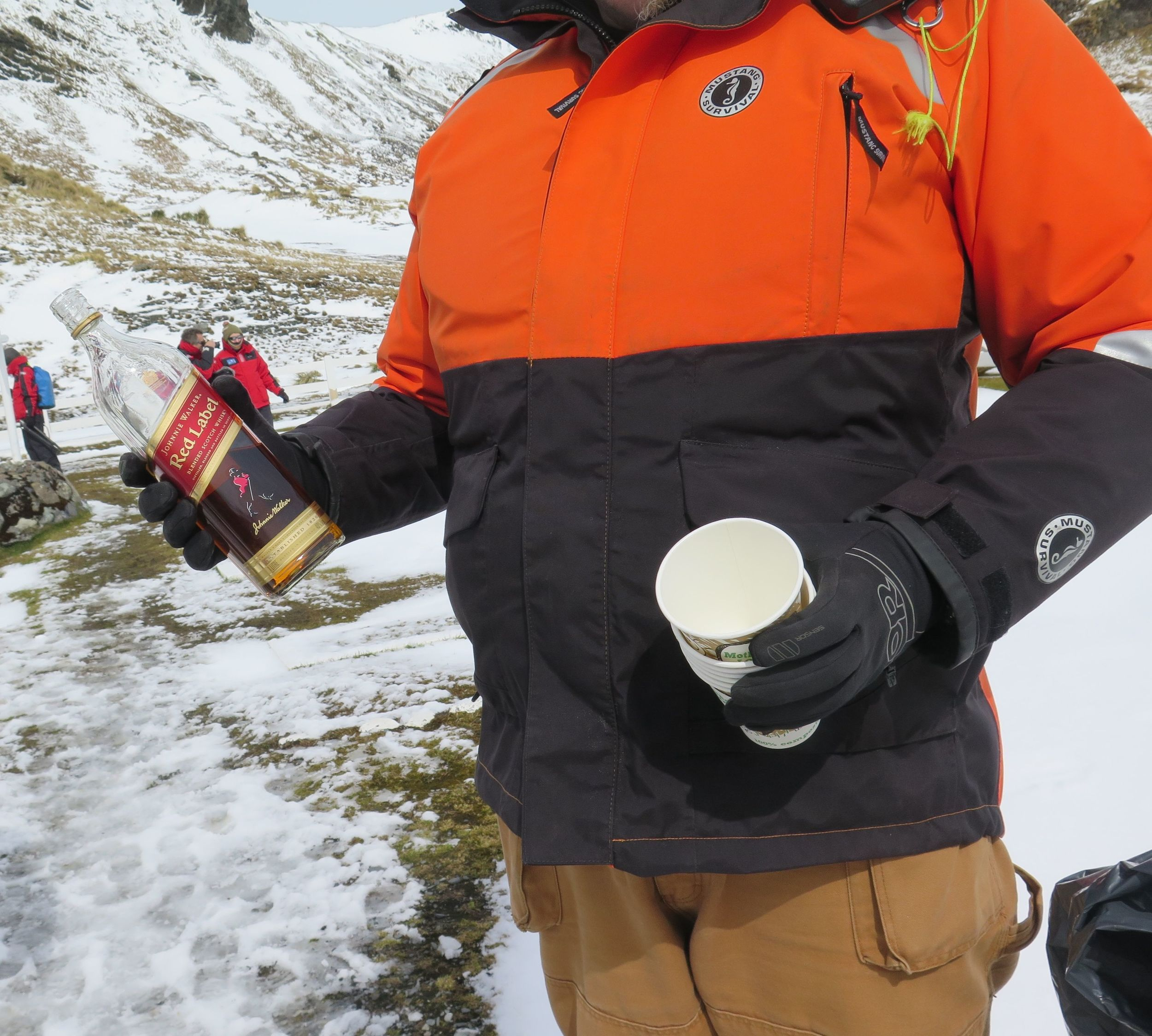 In keeping with the tradition of toasting Shackleton at his grave, a member of our crew welcomed us with a bottle of whiskey.