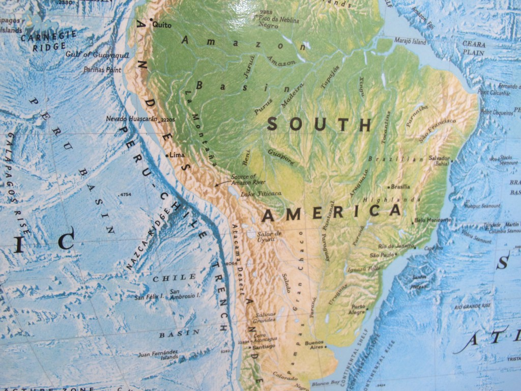 The trench runs along the west coast of South America, suspiciously close to the Andes mountains. Hmmm....a clue?
