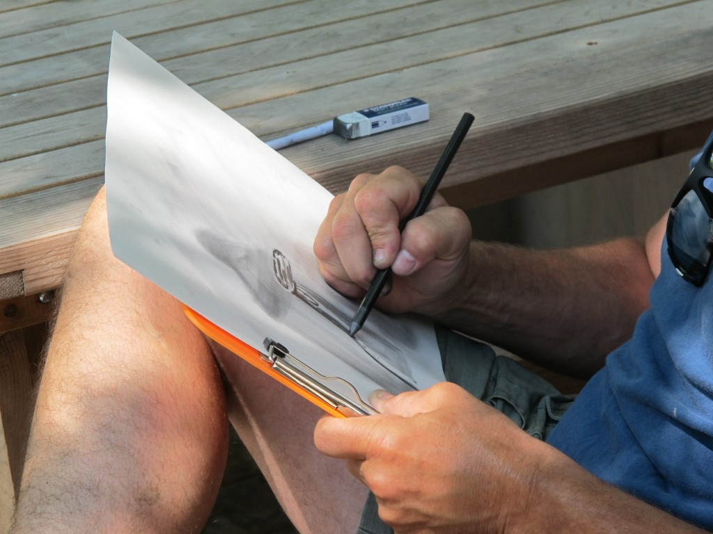 On the tree-shaded deck, each artist tested different drawing media.