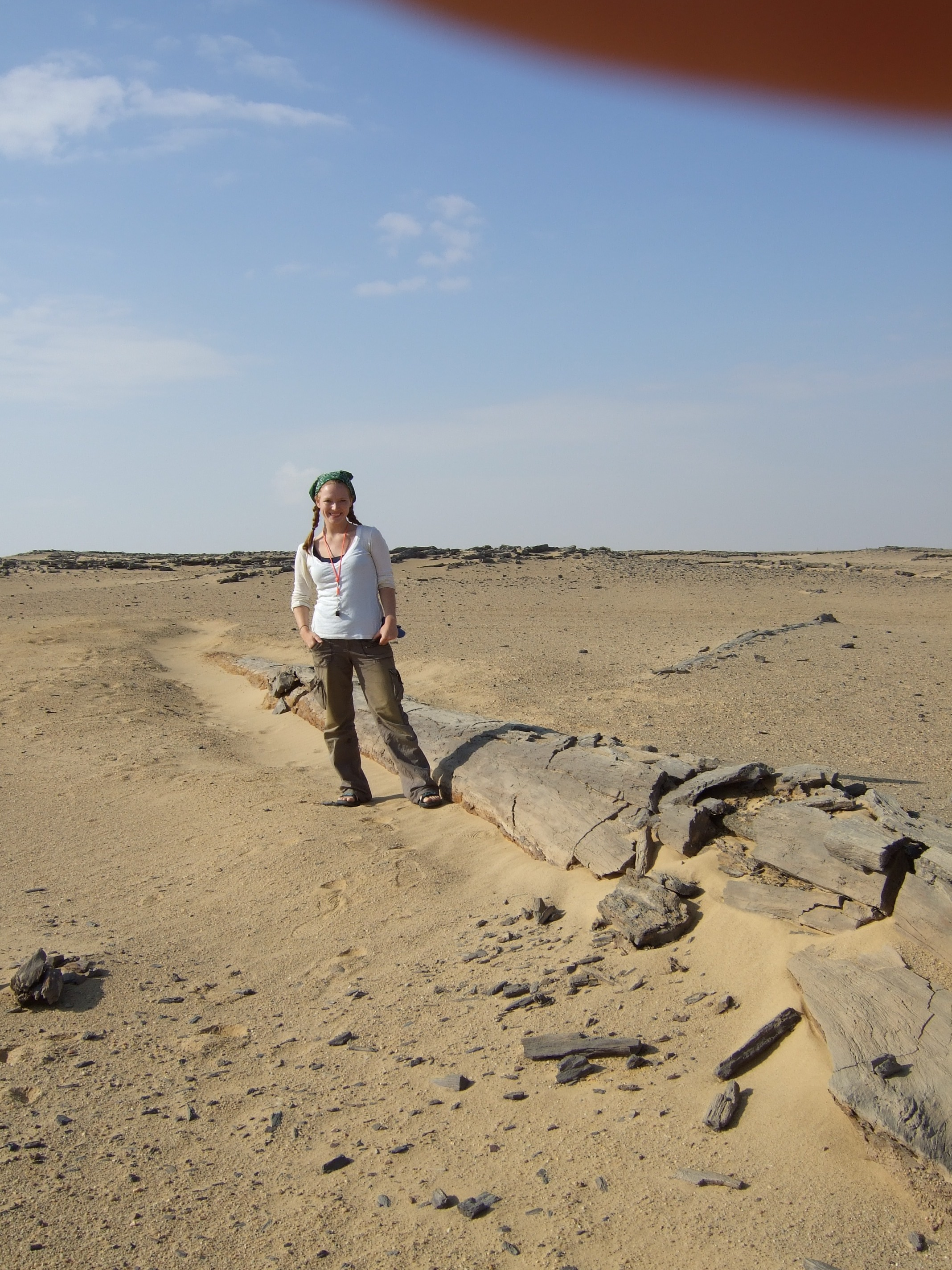 Standing near a petrified tree in the Fayum Depression, Egypt.
