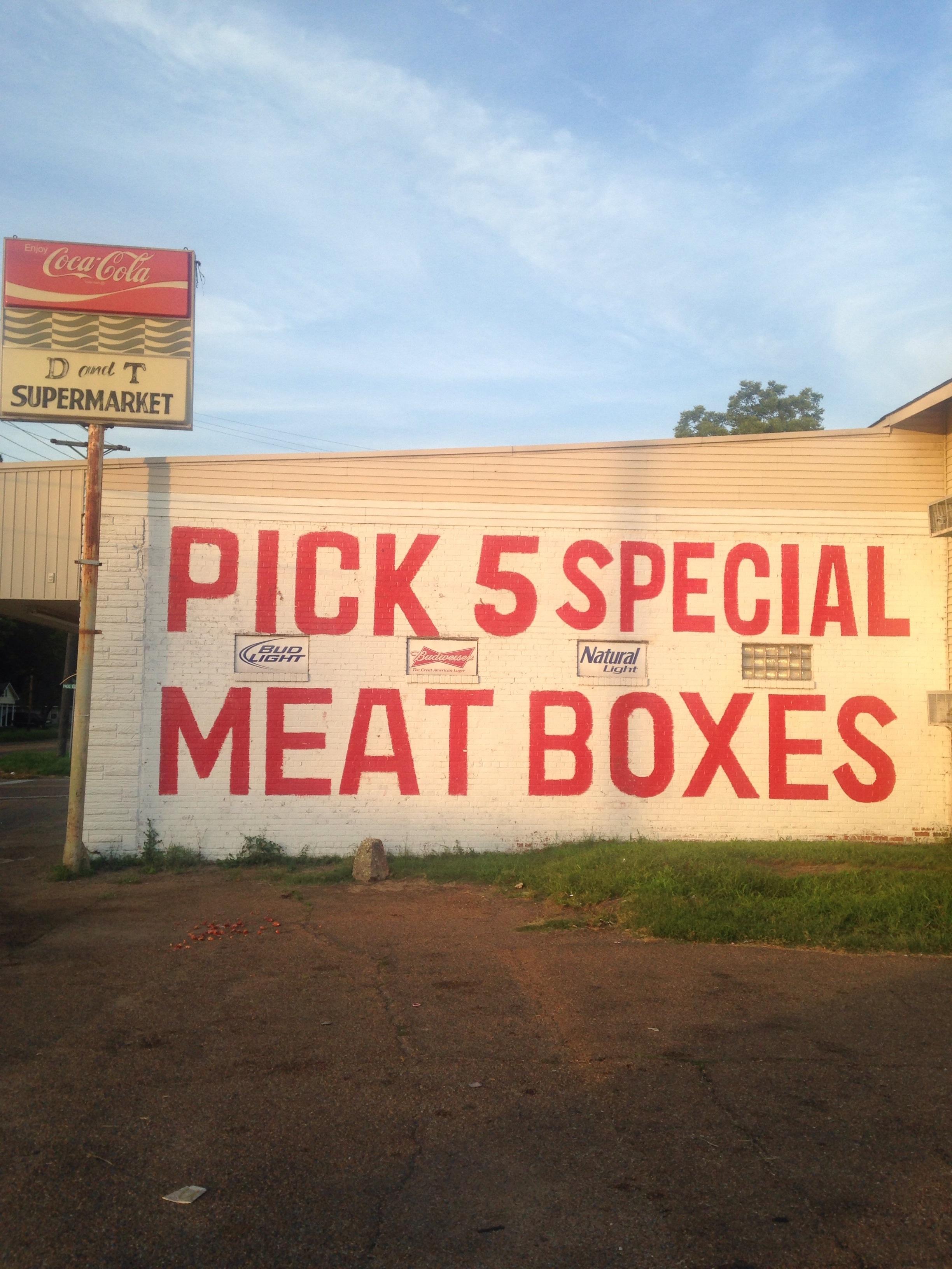 Sign, grocery store, Clarksdale, Mississippi, June 10, 2017.