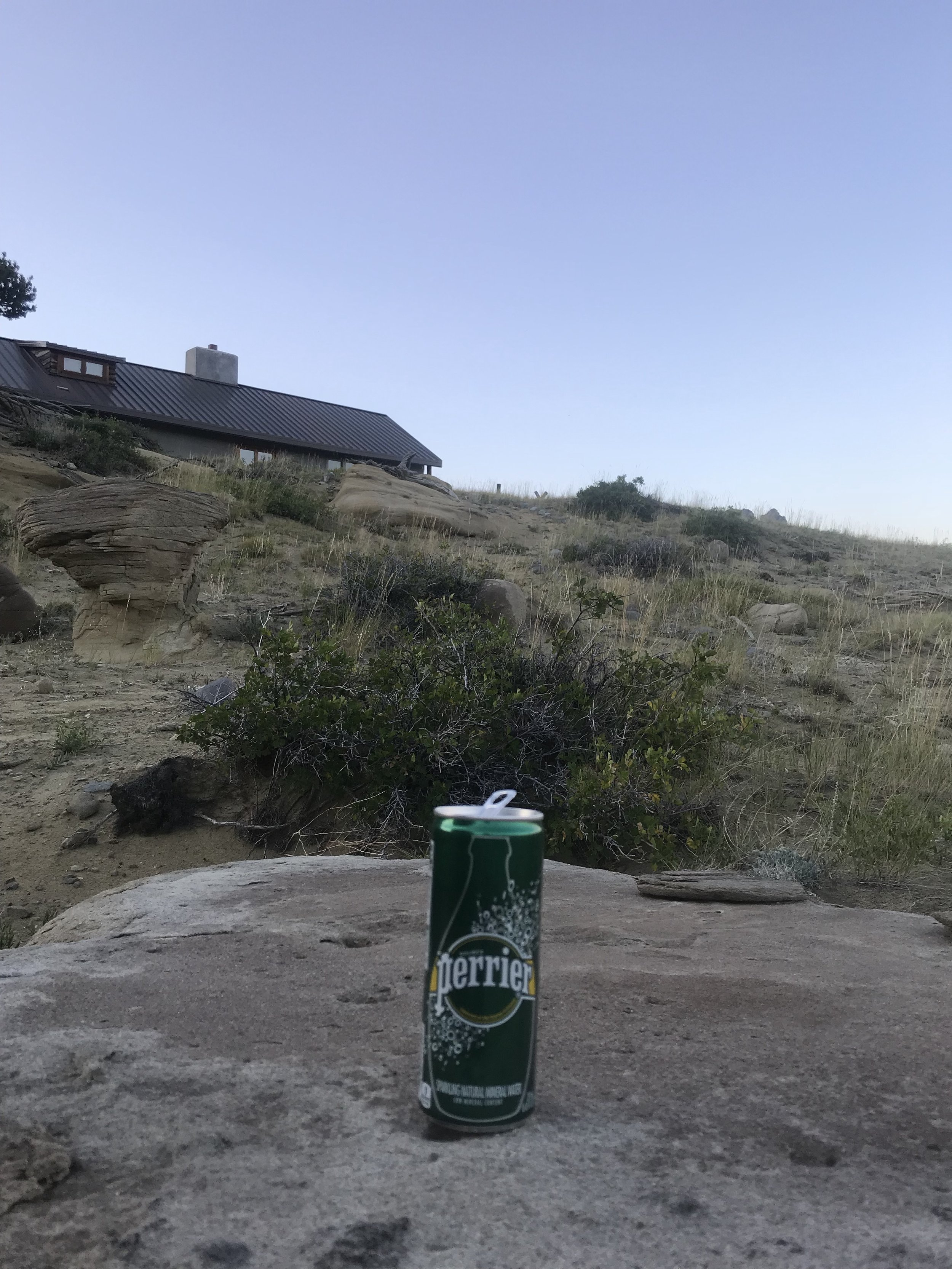 Perrier, now available in convenient 10 oz. cans, poses atop a stone on the Wyoming property of a former copywriter and creative director, Wapiti, Wyoming, 8:50 pm, July 19, 2018.