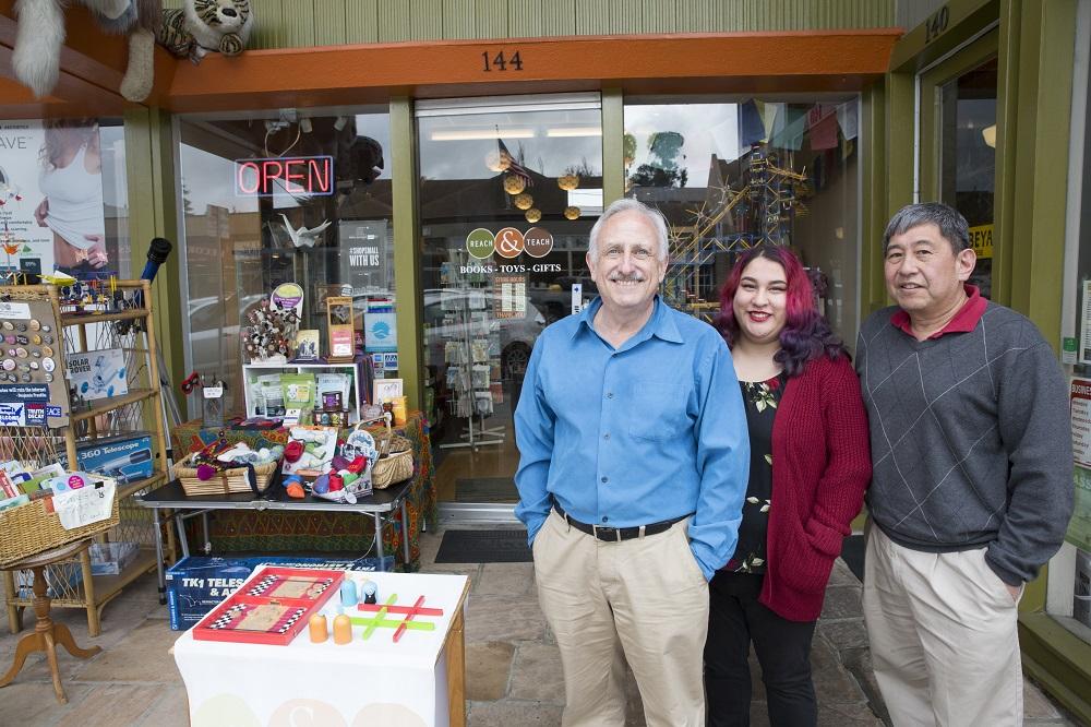 Craig Wiesner, Karina, and Derrick Kikuchi in front on Reach & Teach on 25th Avenue in San Mateo.