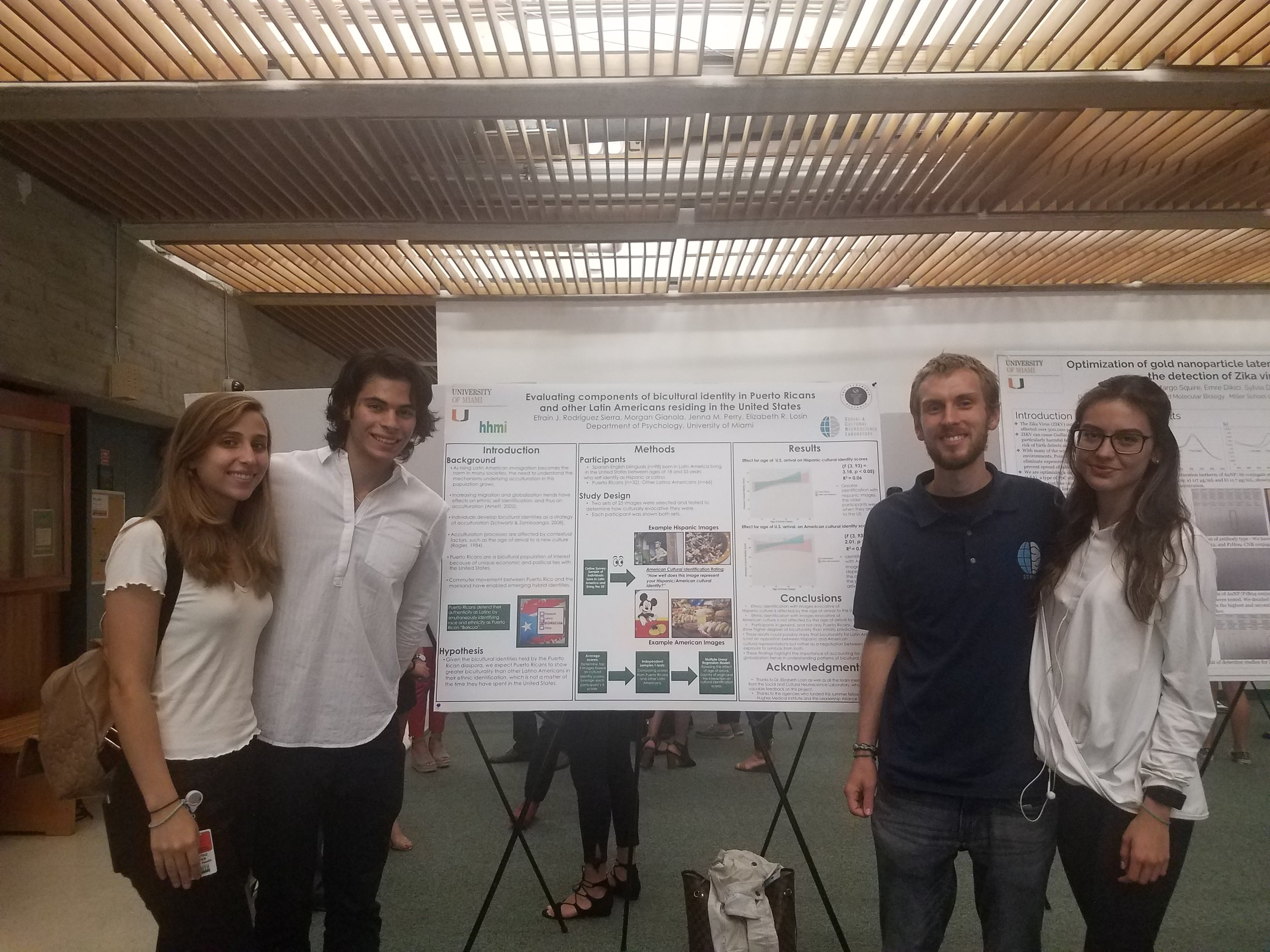 The study team poses with Efra's poster.  From left to right : Beatriz Yepes, Efrain Rodriguez Sierra, Morgan Gianola, Sofia Mercer.