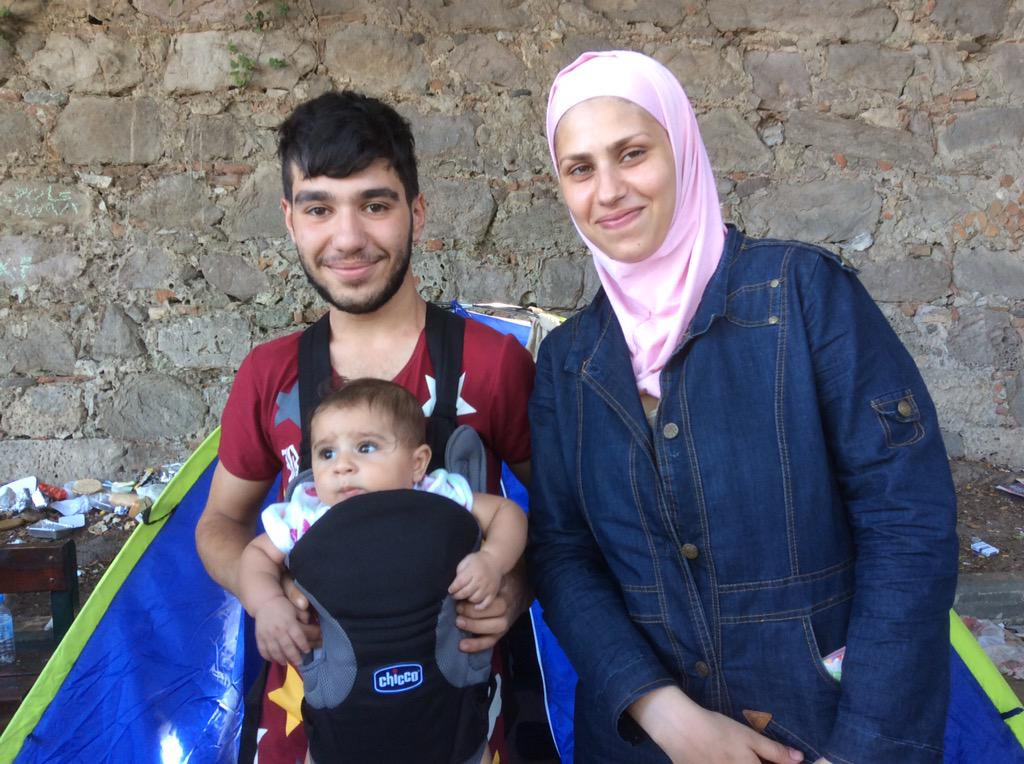 A young family with their new sling from our last donation