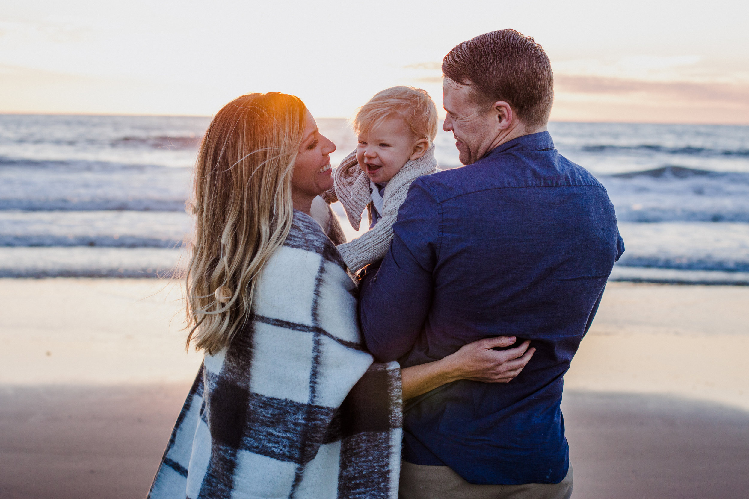 This gorgeous family likes to spend sunsets with their son on the beach. It's a favorite pass-time for them.