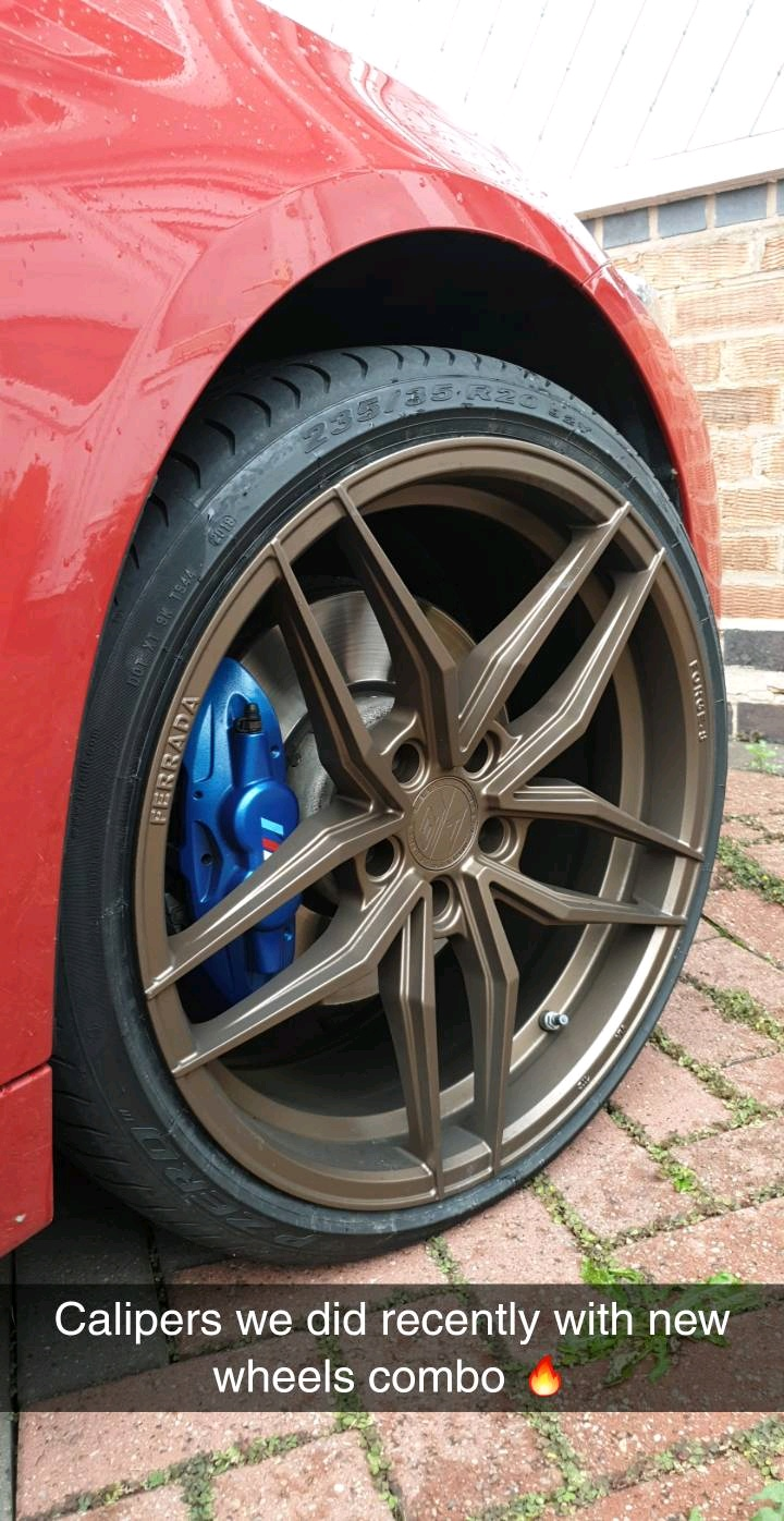 CUSTOM BLUE CALIPERS SITTING PRETTY WITH NEW RIMS