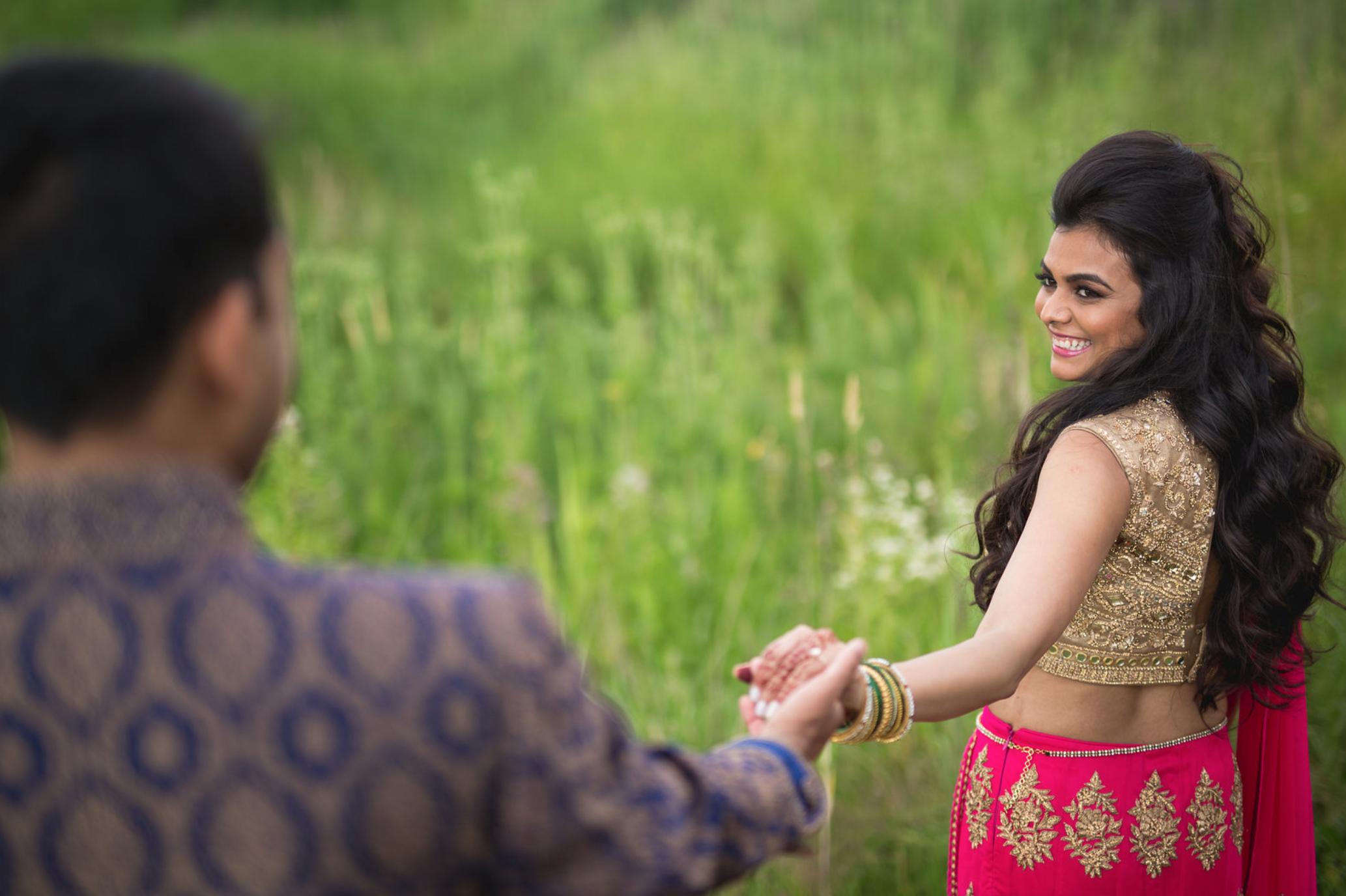 bride-taking-groom-by-hand.jpg