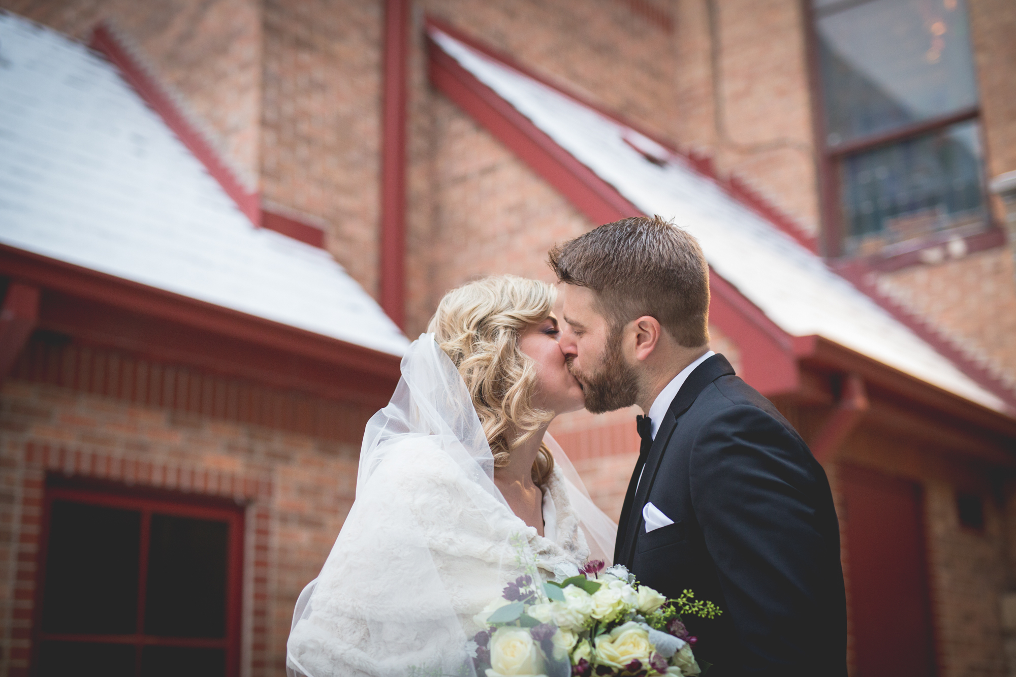 bride-and-groom-in-front-of-assumption-church.jpg
